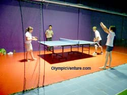 Installed Olymflex rubberized floor for ping pong playing area with table of metal legs for Sports Arena Sentosa, Old Klang Road