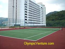 another view of rubberized cushioned tennis court for Equatorial Hotel