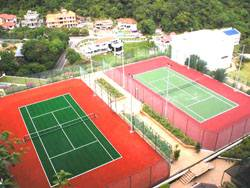 hotel equatorial synthetic grass court and hard court