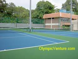 Another view of 2 rubberized cushion tennis courts at Royal Lake Club, KL