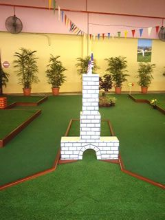tower with malaysian flag decoration on hole 7